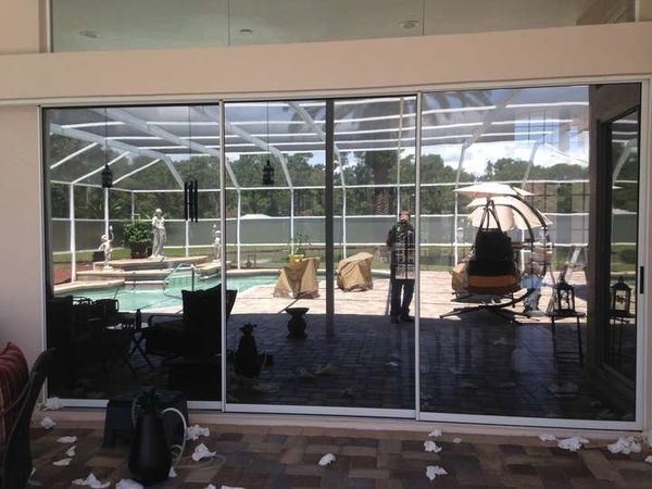 Pool Deck Glass Sliding Door Window Tinting in Hudson, FL (1)